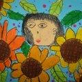 好多太陽花   真美麗  畫誰在看太陽花呢?  還是畫我的媽媽   最美麗!