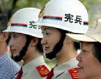 記得共軍確實沒有憲兵。而這新的試點--如共軍制服90改革一樣,又是從香港開始,而且是從女裝先公開。