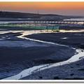 位於竹南的中港溪出海口,每逢過了農曆十月的秋冬之際,漁民會在河道適當位置,架設起一排排高架漁網,也因而形成當地河域相當奇特的景觀。